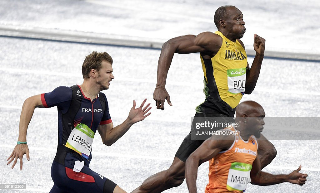 France's Christophe Lemaitre Jamaica's Usain Bolt and Netherlands Churandy Martina compete in the Men's 200m Final during the athletics event at the...