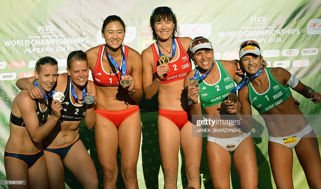 From L, Germany's Karla Borger and Britta Buethe, second place, the winners China's Chen Xue and Xi Zhang and third place Brazilians Barbara Seixas De Freitas and Liliane Maestrini celebrate on the podium after the the Beach Volleyball World Championships on July 6, 2013 in Stare Jablonki.