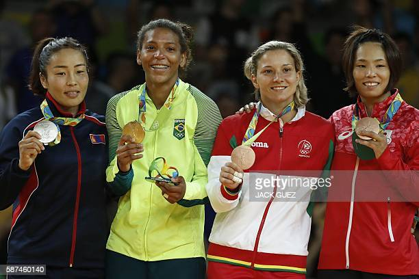 Mongolia's Sumiya Dorjsuren Brazil's Rafaela Silva Portugal's Telma Monteiro and Japan's Kaori Matsumoto pose with their medals on the podium of the...