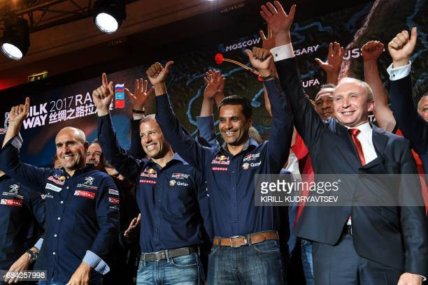 Peugeot's French driver Stephane Peterhansel Toyota's pilots Mathieu Baumel of France and Nasser AlAttiyah of Qatar and Rally Director Vladimir...