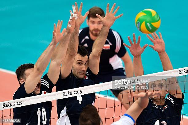 Poland's Szymon Romac Grzegorz Kosok and Adrian Buchowski try to block the ball during the men's quarterfinal volleyball match Poland vs Slovakia at...