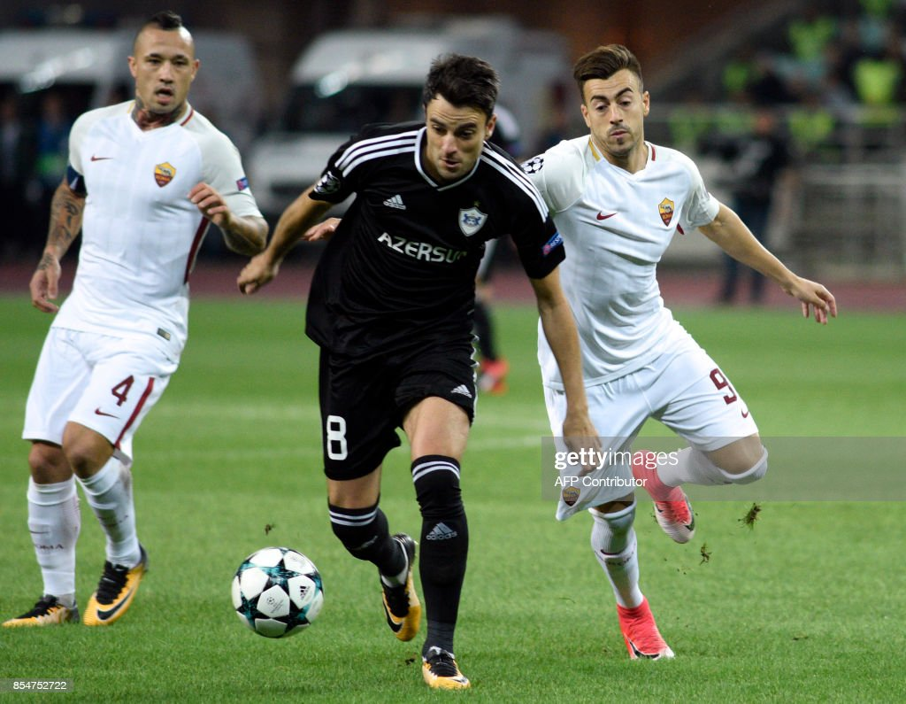Roma's midfielder from Belgium Radja Nianggolan, Qarabag's midfielder from Spain Michel and Roma's forward from Italy Stephan El Shaarawy vie for the ball during the UEFA Champions League Group C football match between Qarabag FK and AS Roma in Baku on September 27, 2017. /