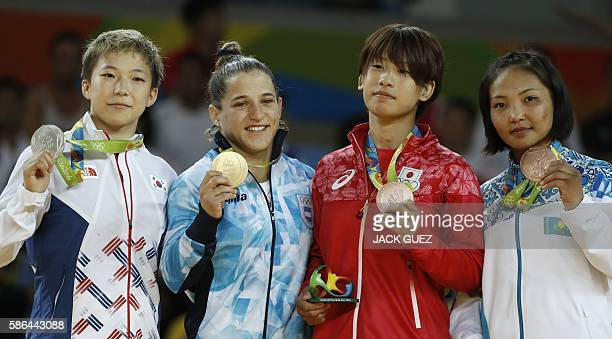Sivler medallist South Korea's Jeong Bokyeong gold medallist Argentina's Paula Pareto and bronze medallists Japan's Ami Kondo and Kazakhstan's...