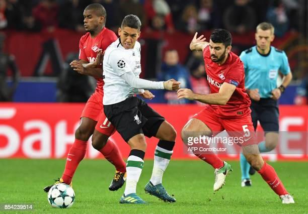 Spartak Moscow's midfielder from Brazil Fernando Liverpool's forward from Brazil Roberto Firmino and Spartak Moscow's defender from Germany Serdar...
