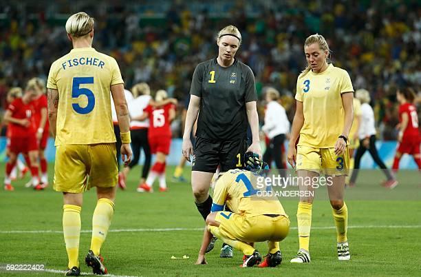 Sweden's defender Nilla Fischer Sweden's goalkeeper Hedvig Lindahl Sweden's midfielder and captain Caroline Seger and Sweden's defender Linda...