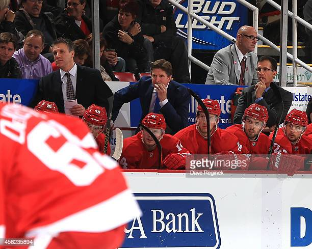 From L to R assistant coach Jim Hiller head coach Mike Babcock and assistant coach Tony Granato watch the action from the bench against the during a...