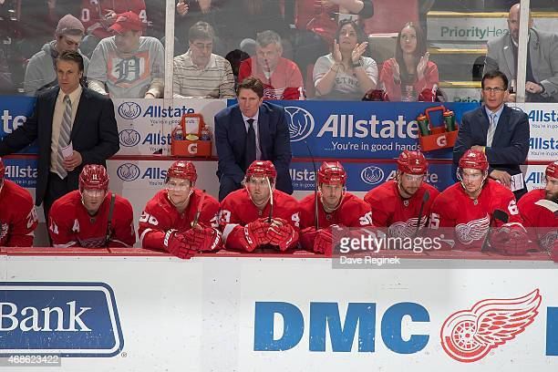 From L to R assistant coach Jim Hiller head coach Mike Babcock and assistant coach Tony Granato of the Detroit Red Wings watch the action from the...