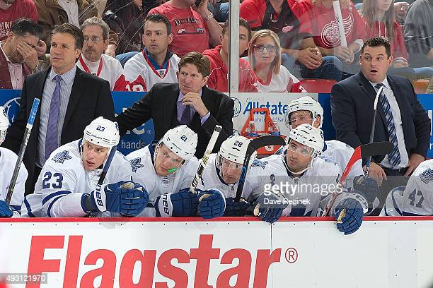 From L to R assistant coach Jim Hiller head coach Mike Babcock and assistant coach D J Smith watch the action from the bench during an NHL game...