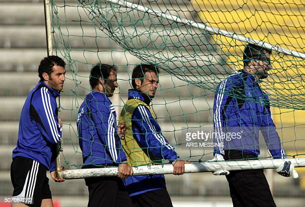 From L to R Greek football players Yiannis Goumas Aggelos Basinas Demis Nikolaidis and Tasos Chalkias carry a goalpost during a training session in...