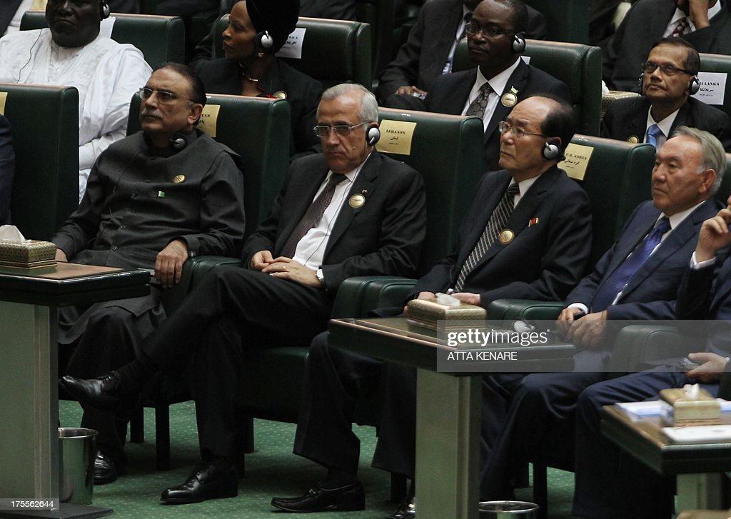 Pakistani President Asif Ali Zardari, Lebanese President Michel Sleiman, Kim Yong-nam (R), North Korea's ceremonial head of state, and Kazakhstan's President Nursultan Nazarbayev listen to a speech by Iran's new president Hasan Rowhani (not seen in photo) after he was sworn in before parliament in Tehran on August 4, 2013. The Islamic republic's new president revealed a cabinet lineup of experienced technocrats, aiming to deliver on his promise of saving the economy and engaging the world. AFP PHOTO/ATTA KENARE