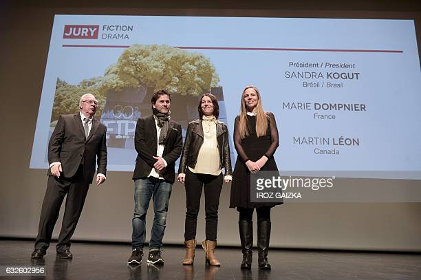 From L to R President of the FIPA festival Didier Decoin and members of the fiction's jury Martin Leon Marie Dompnier and Sandra Kogut pose during...