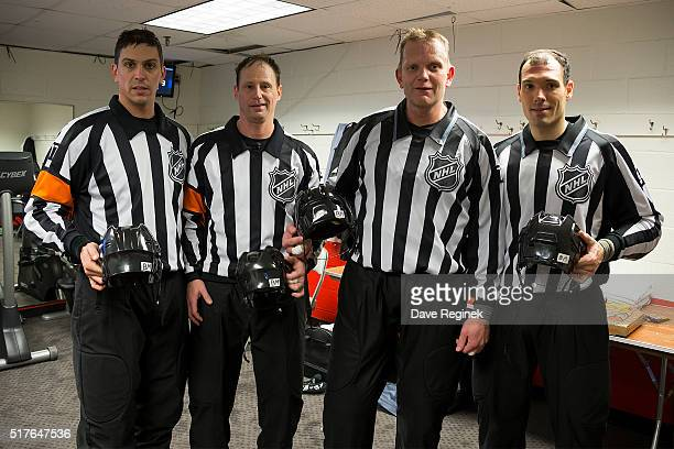 From L to R referee Frederick L'Ecuyer referee Chris Lee linesman Tim Nowak and linesman Bryan Pancich pose with their helmets with a piece of white...
