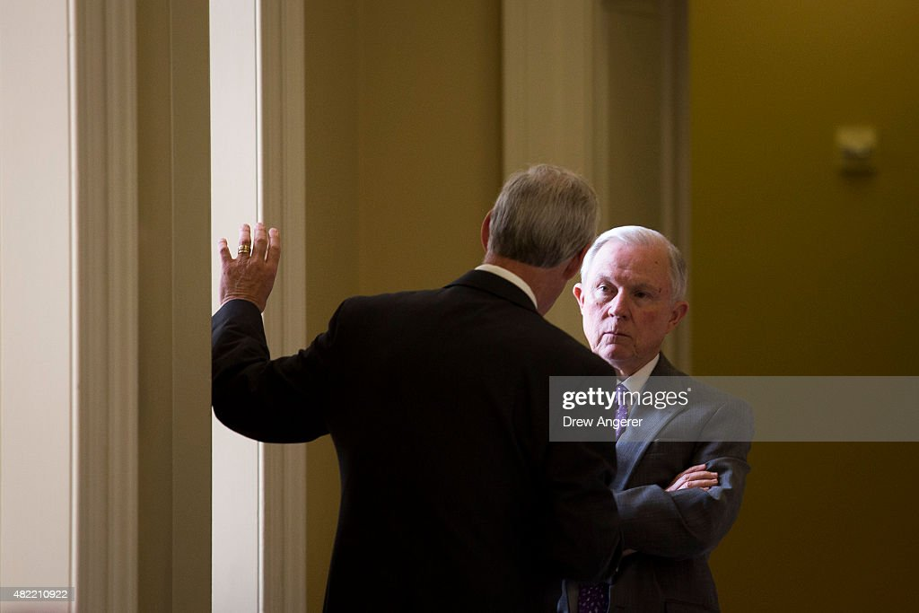 From L to R, Sen. Ron Johnson (R-WI) speaks with Sen. Jeff Sessions (R-AL) after a meeting with Senate Republicans, on Capitol Hill, July 28, 2015 in Washington, DC. On Tuesday, the Senate is continuing to work toward passing a long-term extension of a federal highway bill that is set to expire on Friday.