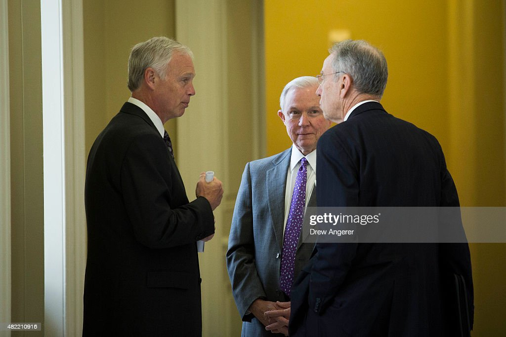 From L to R, Sen. Ron Johnson (R-WI) speaks with Sen. Jeff Sessions (R-AL) and Sen. Chuck Grassley (R-IA) after a meeting with Senate Republicans, on Capitol Hill, July 28, 2015 in Washington, DC. On Tuesday, the Senate is continuing to work toward passing a long-term extension of a federal highway bill that is set to expire on Friday.