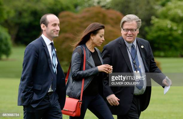 From L to R} Senior policy adviser Stephen Miller Deputy National Security adviser Dina Powell and strategist Steve Bannon exit Marine One on the...