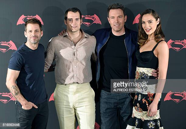 From L to R US film director producer and screenwriter Zack Snyder British actor Henry Cavill US actor Ben Affleck and Israeli actress and model Gal...