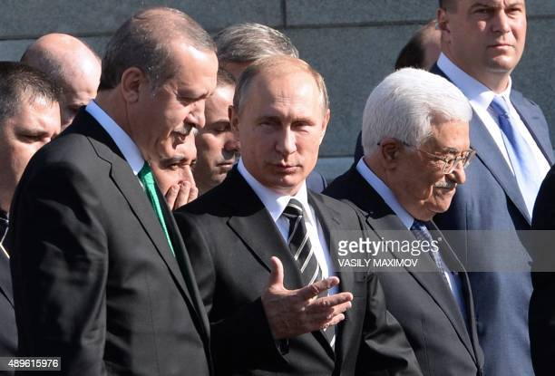 Turkish President Recep Tayyip Erdogan Russian President Vladimir Putin and Palestinian leader Mahmud Abbas arrive for the opening ceremony of the...