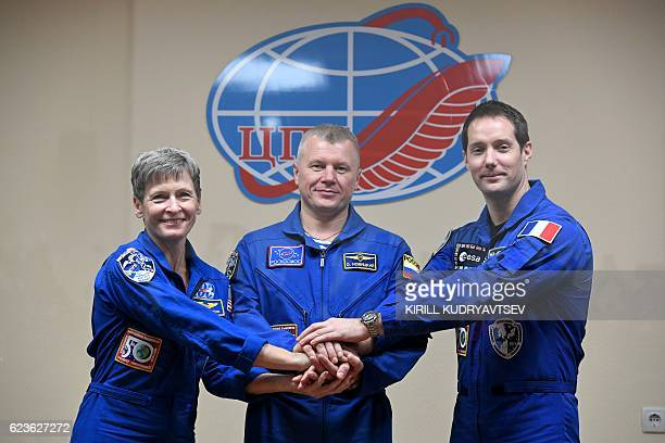 US astronaut Peggy Whitson Russian cosmonaut Oleg Novitsky and French astronaut Thomas Pesquet pose for pictures during a press conference at the...
