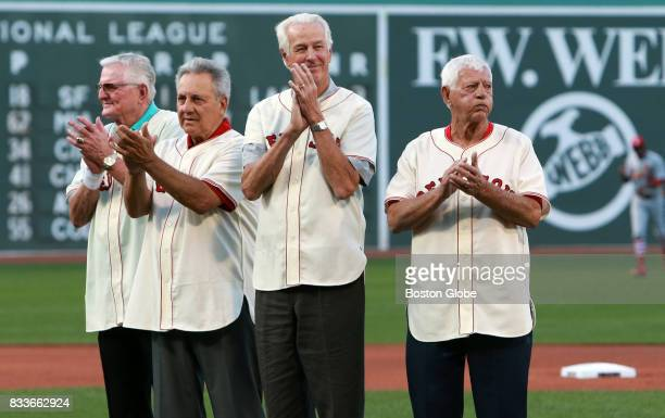 From left 1967 'Impossible Dream' Red Sox team members Ken Harrelson Rico Petrocelli Jim Lonborg and Carl Yastrzemski applaud as they are honored...