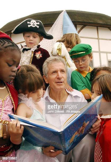 From left actor and author George Layton is surrounded by fairy princesses elves and wizards at Shakespeare's Globe Theatre in London for the...
