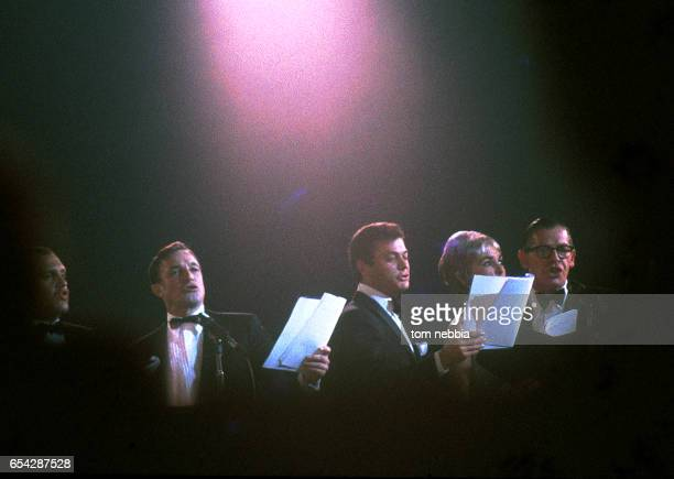 From left actors Alan King Gene Kelly Tony Curtis Janet Leigh and Milton Berle perform onstage at President Kennedy's inaugural ball Washington DC...