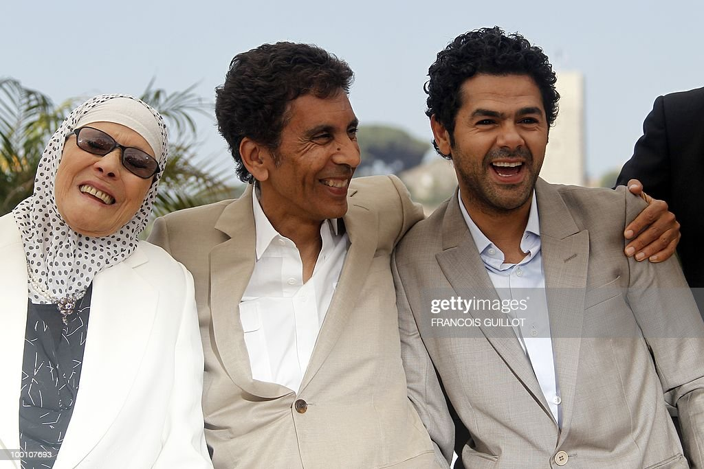 actress Chafia Boudraa, French director Rachid Bouchareb and French actor Jamel Debbouze pose during the photocall of 'Hors La Loi' (Outside of the Law) presented in competition at the 63rd Cannes Film Festival on May 21, 2010 in Cannes.
