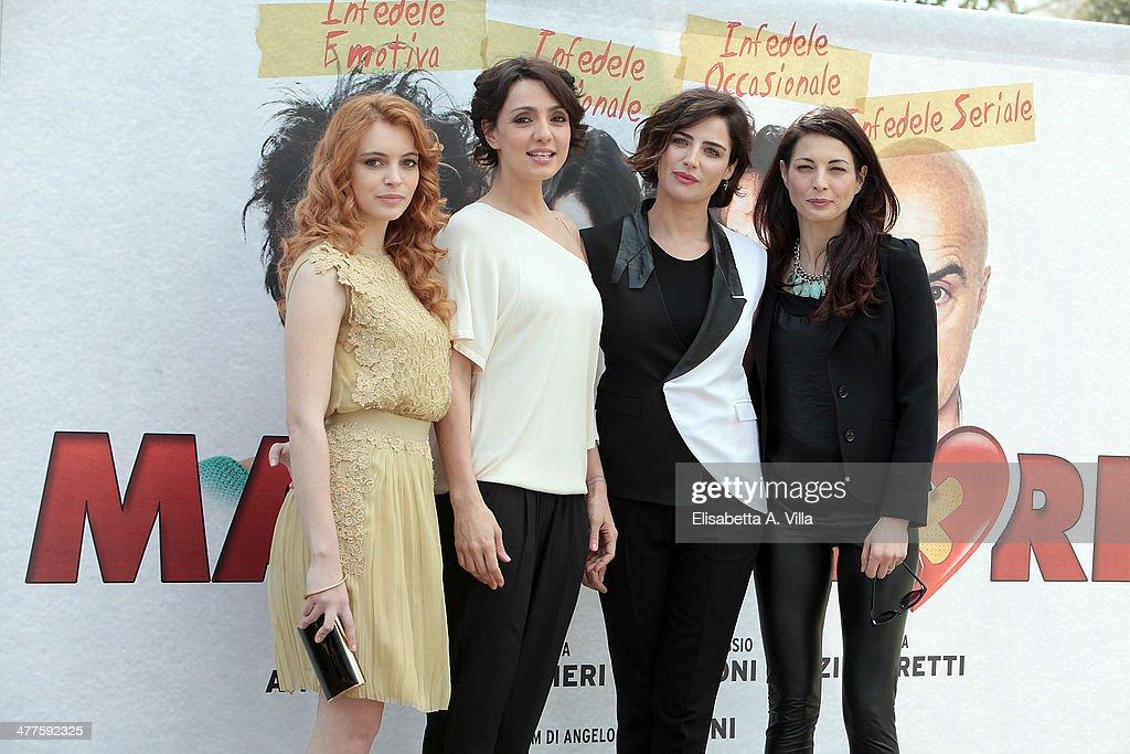 From left actresses Miriam Dalmazio Ambra Angiolini Luisa Ranieri and Eleonora Ivone attend 'Maldamore' photocall at Villa Borghese on March 10 2014...