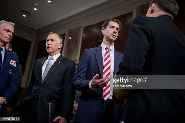 From left Air Force Gen Paul Selva Sens Thom Tillis RNC Tom Cotton RArk and Navy Adm Michael Rogers talk before a Senate Armed Services Committee...