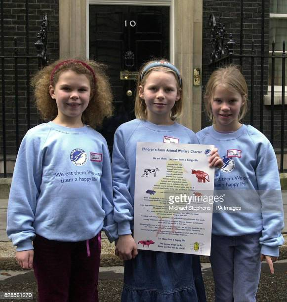 From left Alice Campbell Rosie Hyde 9 and her sister Anna from Edinburgh stand outside No 10 Downing Street Londonas part of a delegation of children...
