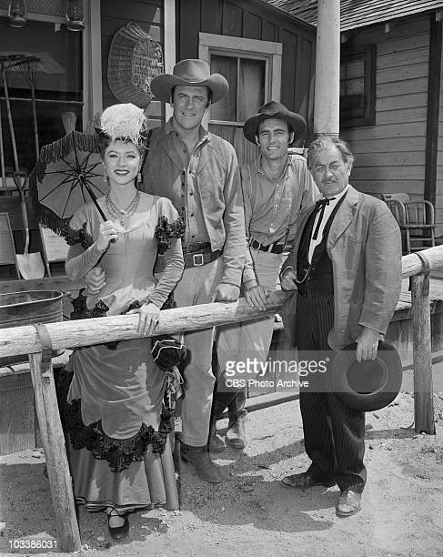 GUNSMOKE From left Amanda Blake as Kitty Russell James Arness as Marshal Matt Dillon Dennis Weaver as Chester Goode and Milburn Stone as Dr Galen...