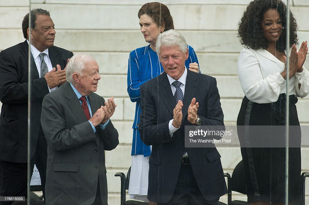 From left Ambassador Andy Young, President Jimmy Carter, Lynda Bird Johnson Robb, President Bill Clinton and Oprah Winfrey attend the 50th Anniversary March on Washington at the Lincoln Memorial in Washington, D.C., on Wednesday, August 28, 2013.