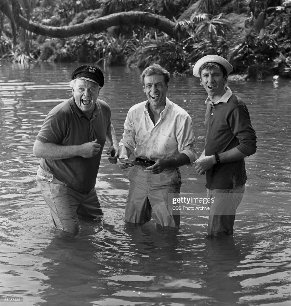From left, American actors Alan Hale Jr. (1918 - 1990) (as the Skipper), Russell Johnson (as the Professor), and Bob Denver (as Gilligan) stand knee-deep in water in the 'Two On a Raft' episode of the televsion show 'Gilligan's Island.' 1966.