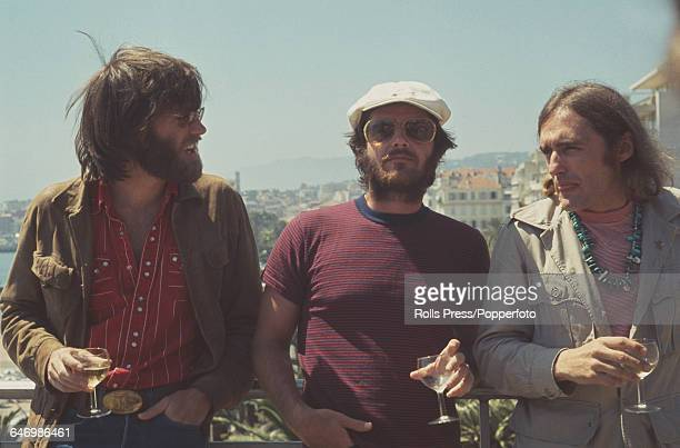 From left American actors Peter Fonda Jack Nicholson and Dennis Hopper pictured together holding galsses of white wine in Cannes France to promote...