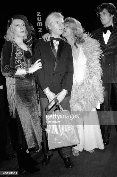 From left American actress Candy Darling pop artist Andy Warhol and actress Sylvia Miles and her companion model Rudolf Martinus attend the premiere...