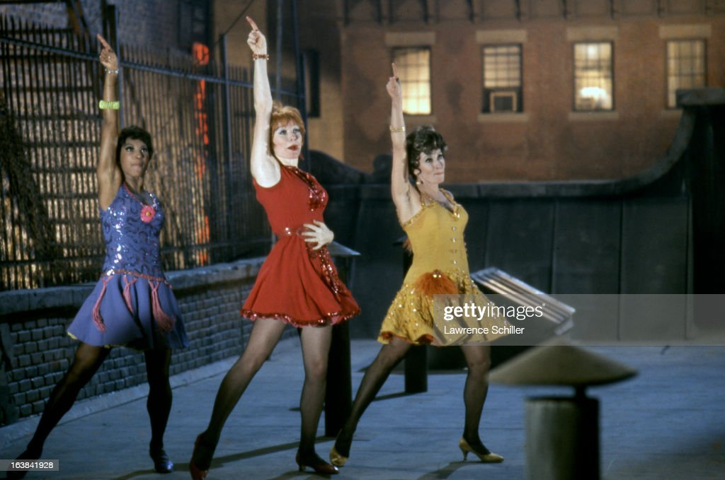 From left, American actresses Paula Kelly, Shirley MacLaine (born Shirley MacLean Beaty), and Chita Rivera (born Dolores Conchita Figueroa del Rivero) dance in a scene from the film 'Sweet Charity' (directed by Bob Fosse) at Universal Studios, Los Angeles, 1969.