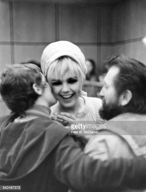 From left American filmmaker and performance artist Barbara Rubin fashion model and actress Edie Sedgwick and film director Ray Wisniewski talk...