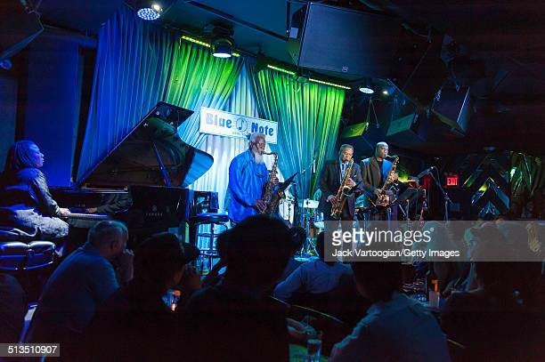 From left American Jazz musicians Geri Allen on piano and tenor saxophonists Pharoah Sanders Odean Pope and James Carter perform with Pope's sextet...