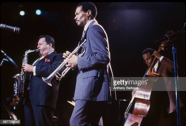 From left American jazz musicians Jackie McLean on saxophone Woody Shaw on trumpet and Cecil McBee on bass perform on stage during the 'One Night...