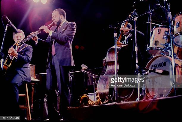 From left American jazz musicians Kenny Burrell on guitar Grover Washington Jr on saxophone and Reggie Workman on bass perform on stage during the...