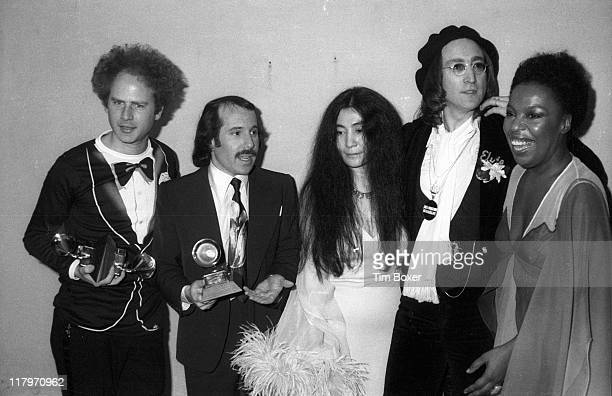 From left American musicians Art Garfunkel and Paul Simon Japanese American musician Yoko Ono her husband British musician John Lennon and American...