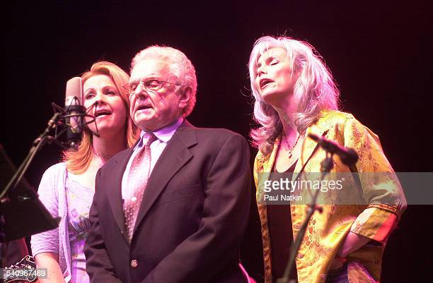 From left American musicians Patty Loveless Ralph Stanley and Emmylou Harris perform together onstage Chicago Illinois July 22 2002