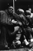 American professional football players Roosevelt Brown Gene Filipski and Don Chandler of the New York Giants watch a football game from the bench...