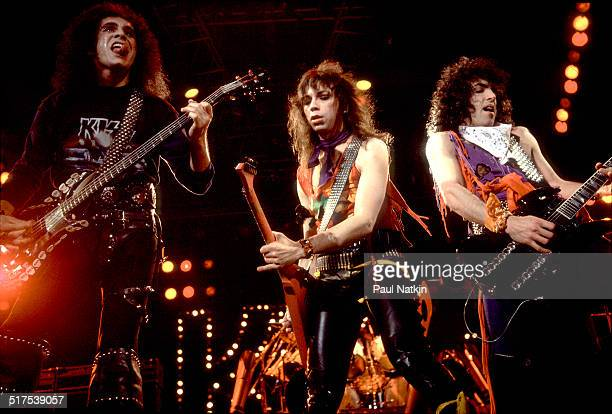 From left American rock musicians Gene Simmons Vinnie Vincent and Paul Stanley all of the group Kiss perform onstage at the UIC Pavillion Chicago...