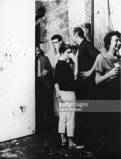 From left American writer LeRoi Jones Joe Rivers married artists Patty and Claes Oldenberg and American critic Rose Slivka attend a party New York...