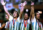 From left Argentine soccer players Gabriel Batistuta Diego Simeone and Leo Rodriguez celebrate their victory 04 July 1993 after they defeated Mexico...