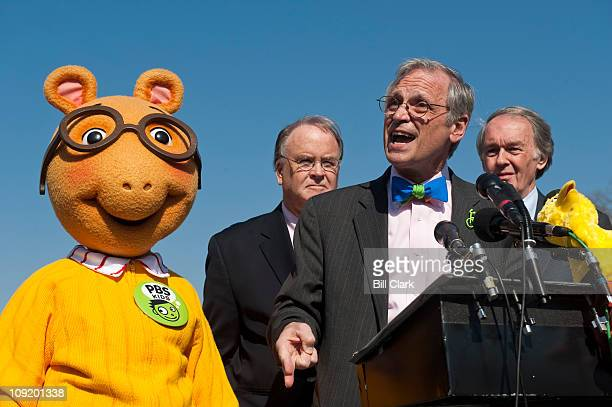 From left Arthur the aardvark from PBS Kids Rep Sam Farr DCalif Rep Earl Blumenauer DOre and Rep Edward Markey DMass hold a news conference to...