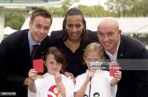 From left back Footballer Graeme LeSaux Athlete Kelly Holmes and Rugby star Phil Greening pose with Emily Wright from Scotts Park Primary School in...