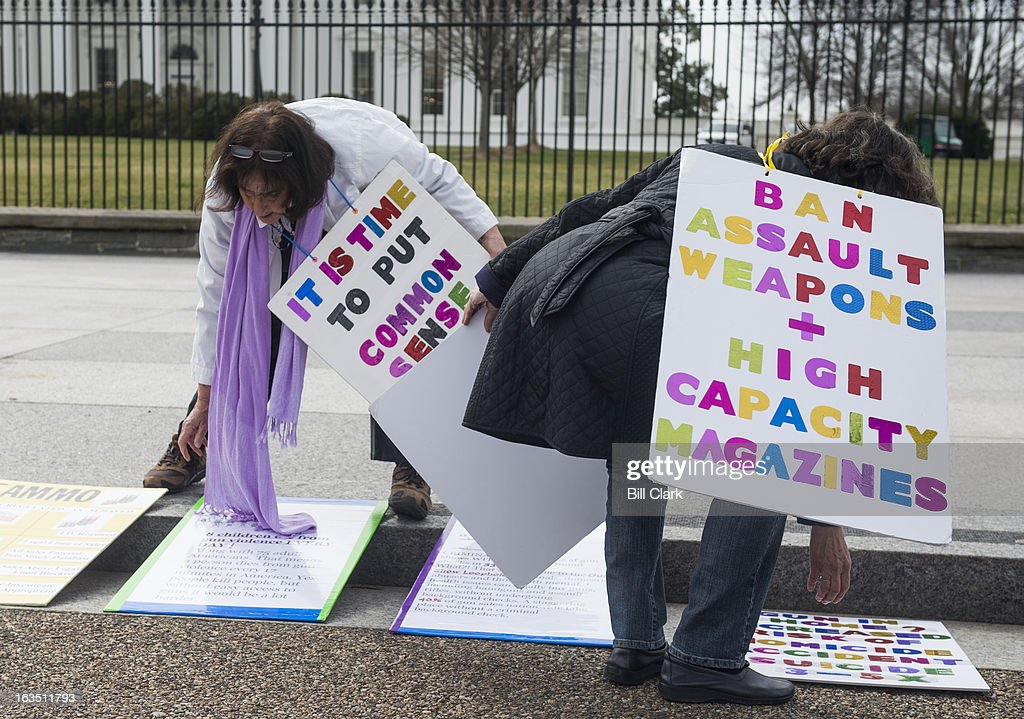 From left, Barbara Elsas and Linda Finkel-Talvadkar set up signs for their weekly demonstration in support of legislation on gun violence prevention and gun safety in front of the White House on Monday, March 11, 2013. The informal group of friends have held weekly demonstrations in front of the White House since the shooting in Aurora, Colo.