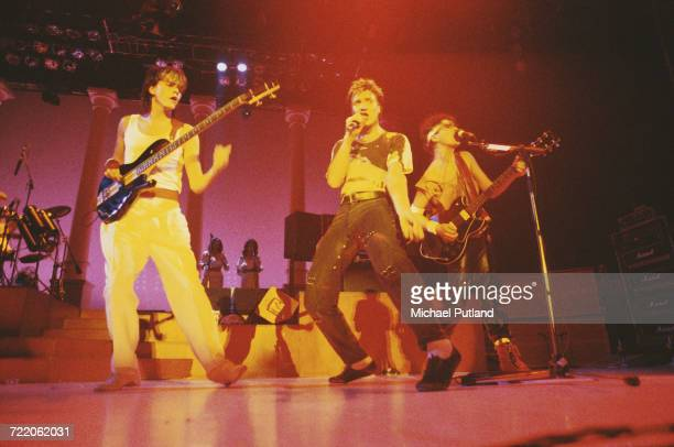 From left bassist John Taylor singer Simon Le Bon and guitarist Andy Taylor of English new romantic group Duran Duran perform live on stage circa 1982