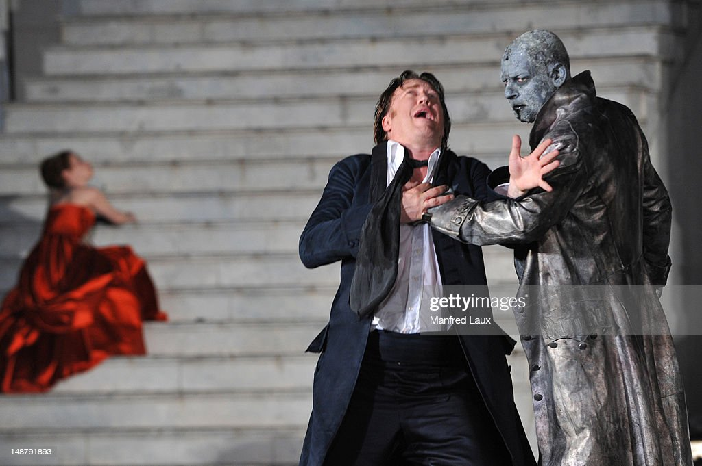 Birgit Minichmayr (Beauty), Nicholas Ofczarek (Everyman) and Ben Becker (Death) is seen during the photo rehearsal of 'Jedermann' (Everyman) on the Domplatz ahead of Salzburg Festival 2012 on July 19, 2012 in Salzburg, Austria. The Salzburg Festival 2012 will run from July 20th til September 2nd 2012.